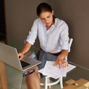 An attractive young woman working from her home office