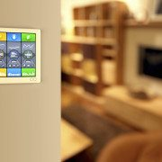 Smart home automation: wall display showing household consumptions related to temperature and heating, power and light, water usage and green energy production. With charts, data and interactive functions for remote control of home facilities and utilities.